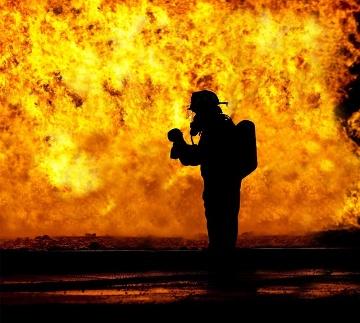 Fireman facing large fire