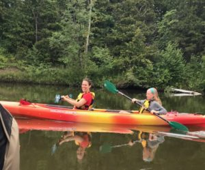 Shira and daughter Tay paddling for a cause.